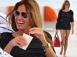 Cocktail hour! Kelly Bensimon shows off her amazing bikini body while enjoying a pina colada on the beach