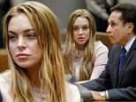 Deciding her fate: Lindsay Lohan and attorney Mark Heller listen at a hearing in Los Angeles Superior Court on Monday as a judge reviews the terms of her probation