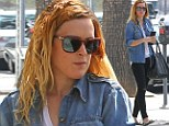 Rumer Willis, sporting a yellow and orange ombre hairstyle, feeds the meter before heading into a meeting in Los Angeles, California