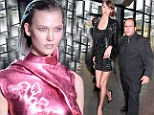 Maybe you should have worn flats! Karlie Kloss towers over her minder before taking Sao Paolo Fashion Week by storm
