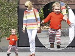 Keep up mommy! January Jones's one-year-old son Xander races ahead of her... as they step out in bold coordinating coloured stripes