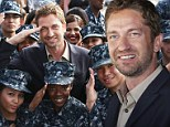 Pirate: Gerard Butler pretended to steer a navy ship at Camp Pendleton in San Diego, California, on Saturday