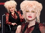 Those really are some True Colours! Cyndi Lauper bright yellow eyeshadow clashes with her hair-raising pink tinged tresses