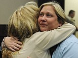 Paula Lowe, (left), hugs her daughter, Lindsey Lowe, before the jury returned a verdict in Lindsey's murder trial today