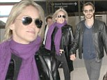 Smitten: Sharon Stone walked hand-in-hand with Martin Mica at the Los Angeles airport, on Tuesday