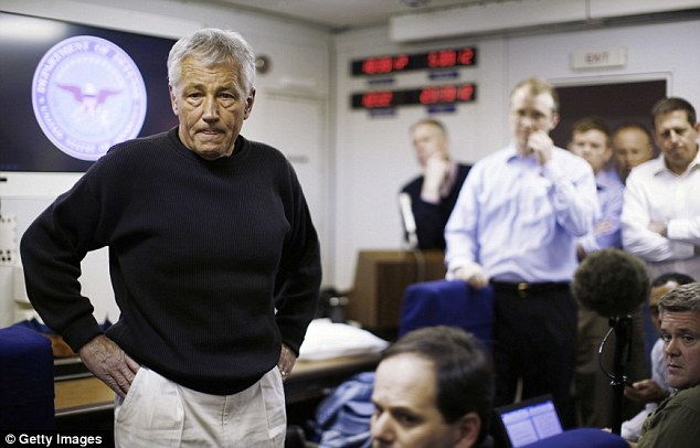 Safe: U.S. Defense Secretary Chuck Hagel, seen on a flight en route to Afghanistan, is in a safe location and unharmed