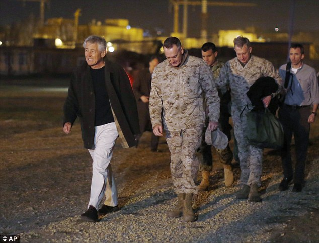 Defense Secretary Chuck Hagel walks with U.S. Marine General Joseph Dunford, commander of the International Security Force, upon Hagel's arrival near Camp Eggers in Kabul, Afghanistan