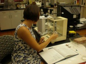 Kim Martin is weighing samples after they have been in the QUV.