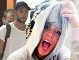 The ring's back on! Miley Cyrus flashes her engagement diamond as Liam Hemsworth jets out of Philippines