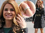 Got something to tell us? Maria Menounos grins as she proudly flashes diamond ring on her engagement finger