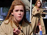 Playing dress-up? Kiernan Shipka dons an oversized coat that drowns her small frame while eating lunch on Mad Men set