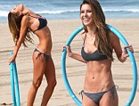 That is how she does it! Audrina Patridge shows off her supreme bikini body as she does a hula hoop workout on the beach