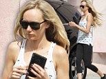Slim mother: Kimberly Stewart exited the gym looking radiant in Los Angeles, on Tuesday
