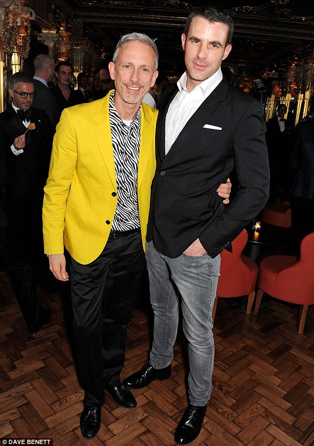 Toasting to a good life: Canadian¿British fashion designer Patrick Cox and a guest