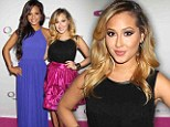 Trying for prim and proper for a change? Serial flasher Adrienne Bailon keeps her modesty intact she poses with Christina Milian