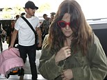 Family flight! Make-up free Drew Barrymore departs out of LAX with husband Will Kopelman and baby daughter Olive