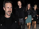 Three's not a crowd! David Arquette clutches onto girlfriend Christina McLarty's hand as they head home after a night of clubbing with blonde pal