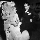 James Dunn, Lyda Roberti and costume designer Charles Le Maire chat between takes of <em>George White's 1935 Scandals</em>
