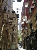 Cages suspended in an alleyway (Wynard, Sydney)