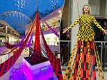 You'll need heels for this one! Designer Henry Holland unveils the world's longest dress at new Trinity Leeds shopping centre