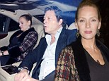 Uma Thurman conceals her little black dress with a fur trim knitted cardigan on evening out alongside Arpad Busson