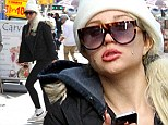 Amanda Bynes appears lost as she slowly walked down the streets of Manhattan