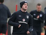 Enigmatic: Wayne Rooney has never delivered in an England shirt in the way many had predicted