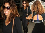 Fit to fly! Brooke Burke-Charvet covers up in black... but makes a feature of her bra as she wears her workout gear to catch a flight