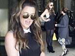 I'm the king of the Kardashian castle! Khloe towers over sister Kourtney as she wears sky-high heels and sheer mini dress to film reality show