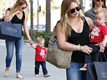 These Converse were made for walking! Hilary Duff's son Luca is steady feet after celebrating his first birthday