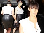 Still slinky: Pregnant Kim Kardashian rocked a leather pencil skirt at a meeting in Beverly Hills on Thursday