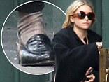 Hey there nanna ankles! Mary-Kate Olsen fails to put her best foot forward wearing some slouchy stockings