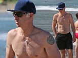 Former Tennis champion John McEnroe, 54, puts a hold on the ageing process as he shows off his toned physique