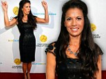 Going solo: Dina Eastwood attends event without husband Clint after it emerges that their ongoing 'feud' almost 'ruined' his daughter's wedding
