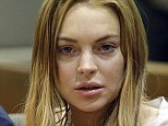Cutting a break! Lindsay Lohan avoids assault charges after 'punching a psychic in a New York club'