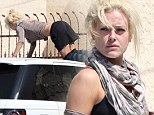 A good spot for sunbathing? DWTS dancer Petra Murgatroyd climbs atop Land Rover to lie face down with her derriere in the air