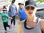 Left in the dust! Gwen Stefani lags behind her two energetic sons as they race ahead during family hike together