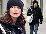 Biker chick: Keira wrapped up from the elements in her favourite beanie hat, jeans and black leather biker jakcet
