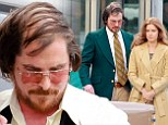 Master chameleon: Batman star Christian Bale was snapped sporting a combover and a paunch on set of his new film with Amy Adams on Thursday in Natick, Massachusetts