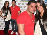 Still going strong! Jersey Shore's feuding couple Sammi 'Sweetheart' and Ronnie Ortiz-Magro cosy up together at the circus