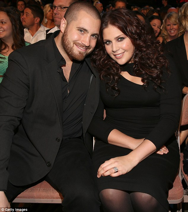 Proud parents: Lady Antebellum singer Hillary Scott and drummer husband Chris Tyrrell have discovered they are having a girl