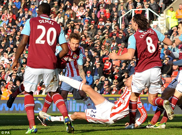 Crash, bang, wallop: Matt Taylor and Peter Crouch clashed in the first haf, forcing the Hammer off