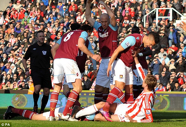 Fury: Winston Reid hit out at Crouch as the Stoke striker lay on the floor next to the injured Taylor