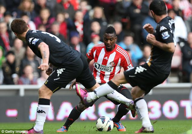 No way: Stephane Sessegnon of Sunderland finds his route towards goal blocked