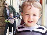 Walking on his own! January Jones' son Xander proudly displays his new toy car