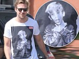 Home Alone fan? Ryan Gosling shows off his impressive biceps in Macauley Culkin T-shirt while pumping gas