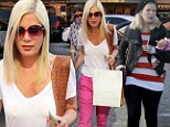 Has stress of divorce rumours taken a toll on Tori Spelling? New mother reveals drastic weight loss