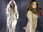 Bet that was tricky to get into! Jennifer Lopez displays her famous curves in an extremely tight glittering jumpsuit