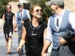 The smile that says I¿m in love! Britney Spears beams as she holds hands with her 'everyday Dave'