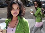 Feeling frisky! Janice Dickinson shows her playful side on (very big) coffee run to Starbucks